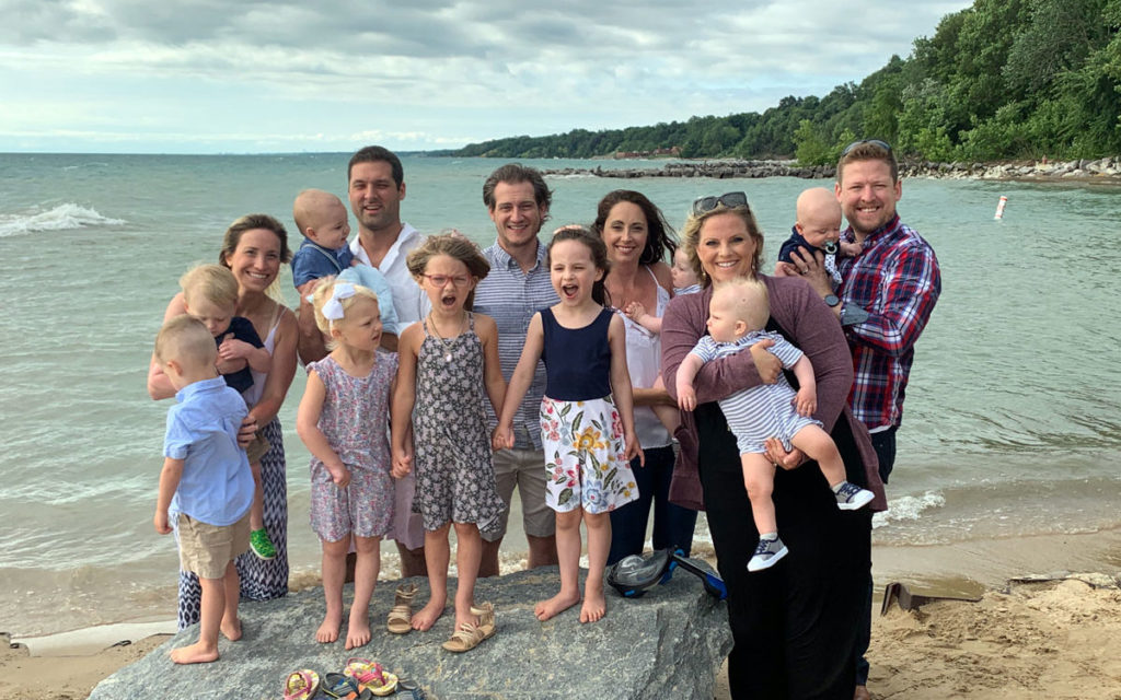 Family baptism at the beach